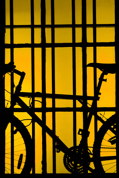 A bicycle on yellow window