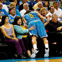 October 27, 2010; New Orleans, LA, USA; New Orleans Hornets shooting guard Marco Belinelli (8) of Italy runs into fans sitting courtside during the second quarter at the New Orleans Arena. Mandatory Credit: Derick E. Hingle