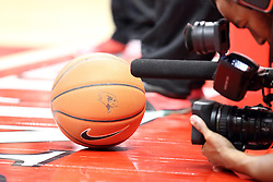 28 January 2015:  A videographer takes some frames of the official game ball complete with the battle bird logo  during an NCAA MVC (Missouri Valley Conference) men's basketball game between the Missouri State Bears and the Illinois State Redbirds at Redbird Arena in Normal Illinois