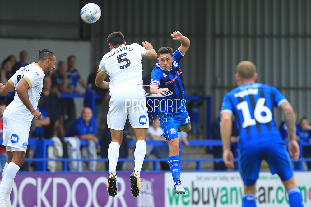 Ian Henderson wins a header during the EFL Sky Bet League 1 match between Rochdale and Peterborough United at Spotland, Rochdale, England on 11 August 2018.
