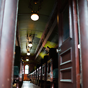 The interior of a passenger train at the B&O Railroad Museum. The B&O Railroad Museum in Mount Clare in Baltimore, Maryland, has the largest collection of 19th-century locomotives in the United States.