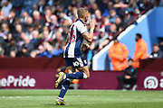 West Bromwich Albion striker (on loan from Newcastle United) Dwight Gayle (16) scores a goal and celebrates  0-1 during the EFL Sky Bet Championship first leg Play Off match between Aston Villa and West Bromwich Albion at Villa Park, Birmingham, England on 11 May 2019.