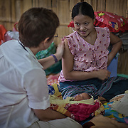 A British doctor checks on the health of patients at a neonatal clinic inside the Mae Hla refugee camp along the Thai-Burma border.