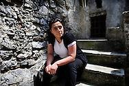 Verbicaro, Italia - 4 giugno 2011. Mirella Ruggiero, 27 anni, vicesindaco del paese di Verbicaro in Calabria fotografata nel centro storico del paese. Mirella è la prima di sei figli ed è laureata..Ph. Roberto Salomone Ag. Controluce