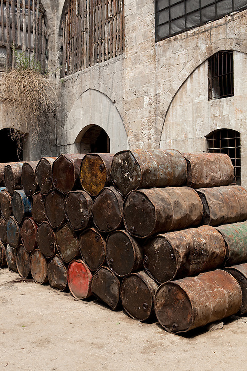Stacks of olive oil barrels at a traditional soap factory, Aleppo, Syria