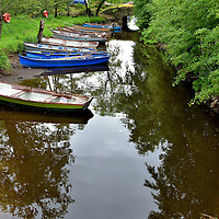 Fishing Boats near Ross Castle in Killarney, Ireland <br />