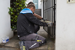 Workmen erect hoardings around a row of private homes on Westborne Grove as shops and properties in the west London area of the Notting Hill Carnival prepare for the hundreds of thousands of revellers by erecting protective hoardings. London, August 24 2018.