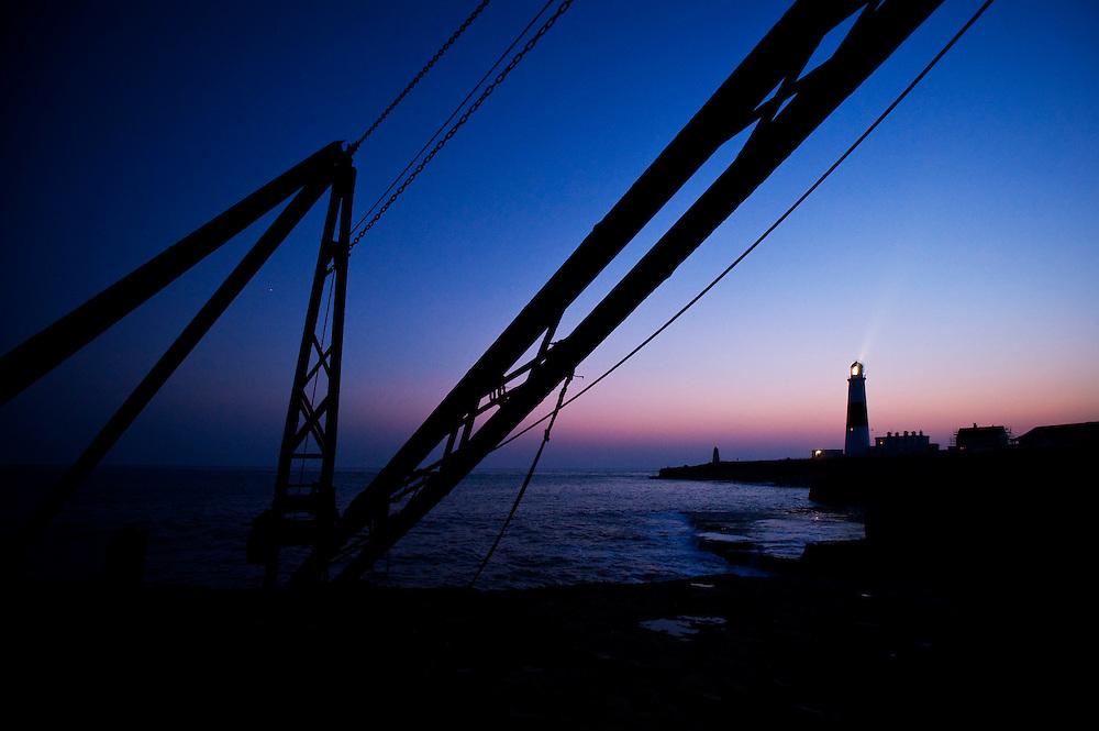 Disused sea quarry crane at Portland Bill Lighthouse, Portland, Dorset, England, UK.