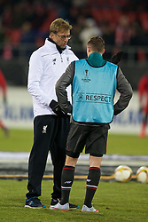 LIVERPOOL, ENGLAND - Thursday, December 10, 2015: Liverpool's manager Jürgen Klopp chats to Brad Smith before the UEFA Europa League Group Stage Group B match against FC Sion at Stade de Tourbillon. (Pic by David Rawcliffe/Propaganda)