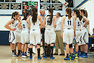 MMU head coach Marty Derda talks to the team during a time out during the girls basketball game between the North Country Falcons and the Mount Mansfield Cougars at MMU high school on Monday night February 15, 2016 in Jericho. (BRIAN JENKINS/for the FREE PRESS)