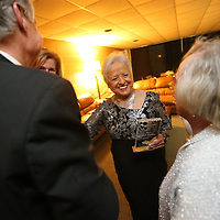 Joesfina Rayburn, center,  spends a few minutes with close friends after she was named the 2018 Citizen of the Year by the Tupelo Junior Auxillary Friday night.