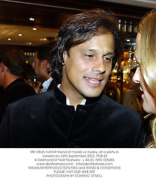 MR ARUN NAYAR friend of model Liz Hurley, at a party in London on 24th September 2003.PNB 65