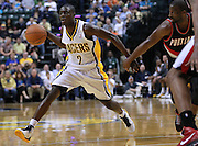 March 13, 2012; Indianapolis, IN, USA; Indiana Pacers point guard Darren Collison (2) dribbles the ball around the backcourt against the Portland Trail Blazers at Bankers Life Fieldhouse. Indiana defeated Portland 92-75. Mandatory credit: Michael Hickey-US PRESSWIRE
