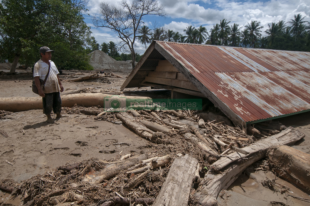 April 29, 2019 - Sigi, Central Sulawesi, Indonesia - A resident was near his house which was buried in mud in a flash flood in Bangga Village, South Dolo Subdistrict, Sigi Regency, about 70 kilometers south of Palu City, Central Sulawesi Province, Indonesia on Monday ( April 29, 2019). The disaster that occurred on Sunday (April 28, 2019) at around 19:00 local time hoarded hundreds of houses, houses of worship, and schools in two villages, namely the Bangga and Balongga Village. (Credit Image: © Basri Marzuki/NurPhoto via ZUMA Press)