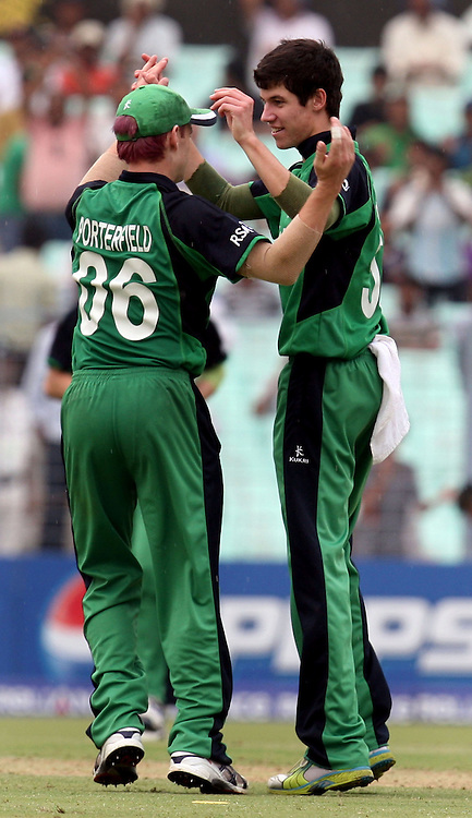 Ireland bowler George Dockrell celebrates with captain William Porterfield South African batsman  Morne van Wyk wicket during the ICC Cricket World Cup - 34th Match, Group B South Africa vs Ireland Played at Eden Gardens, Kolkata, 15 March 2011 - day/night