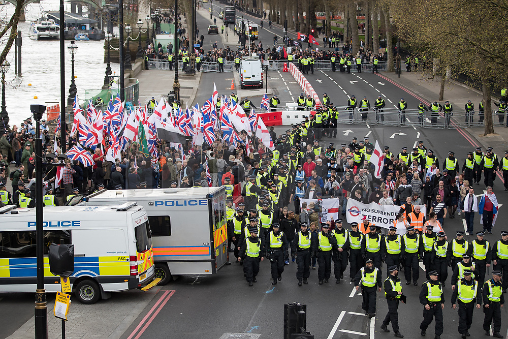 © Licensed to London News Pictures . 01/04/2017 . London , UK . The EDL demo passes along Victoria Embankment beside the Britain First demo on the left . The EDL and Britain First both hold demonstrations in London , opposed by anti-fascist groups , including Unite Against Fascism . Photo credit : Joel Goodman/LNP