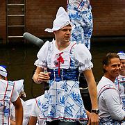 NLD/Amsterdam/20100807 - Boten tijdens de Canal Parade 2010 door de Amsterdamse grachten. De jaarlijkse boottocht sluit traditiegetrouw de Gay Pride af. Thema van de botenparade was dit jaar Celebrate, BNN boot, Koen Swijnenberg