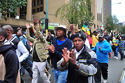 JOHANNESBURG, SOUTH AFRICA – APRIL 07: ANCYL and ANC members march through Beyers Naude Square to gather outside Luthuli House in support of the ANC and Zuma amidst calls for President Zuma to step down, in Johannesburg, South Africa, 07 April 2017. Businesses closed and South Africans from numerous political, religious, labour and civic groups gathered at central points across the entire country protesting against President Zuma's recent government reshuffle appointing 10 new ministers and 10 new deputy ministers including the axing of the finance minister. Photo: Dino Lloyd