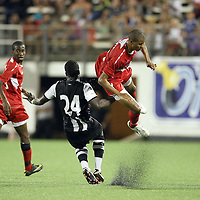 Orlando City Lions Forward Maxwell Griffin (11) gets tripped up by Newcastle United Midfielder Cheik Tiote (24) during an International Friendly soccer match between English Premier League team Newcastle United and the Orlando City Lions of the United Soccer League, at the Florida Citrus Bowl on Saturday, July 23, 2011 in Orlando, Florida. Orlando won the match 1-0. (AP Photo/Alex Menendez)