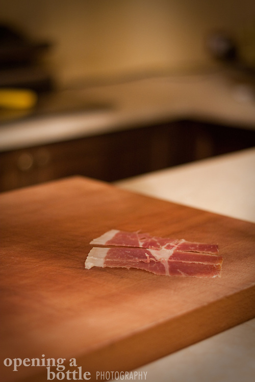 Slices of prosciutto di Parma served as samples for customers of a norceria, Assisi, Umbria, Italy.