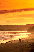 Image of a couple on the beach at sunset at Anglesea, Victoria, Australia, model released