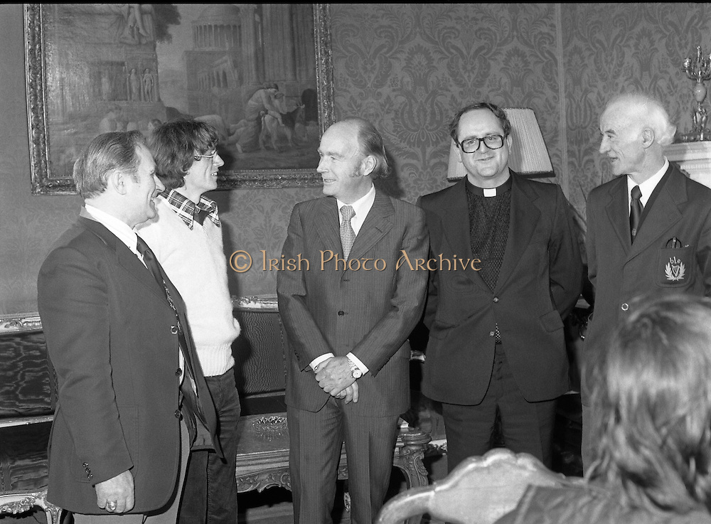 31/03/1978.03/31/1978.31st March 1978.John Treacy meets the President..Photograph of President Hillery chatting with World Cross Country Winner John Treacy, when he was received at Aras an Uachtarain, Dublin. Also present were from left, Bill Coghlan, President B.L.E, Fr. Michael Enright, Abbeyside, Dungarvan, and Brendan Foreman, National Secretary, B.L.E.