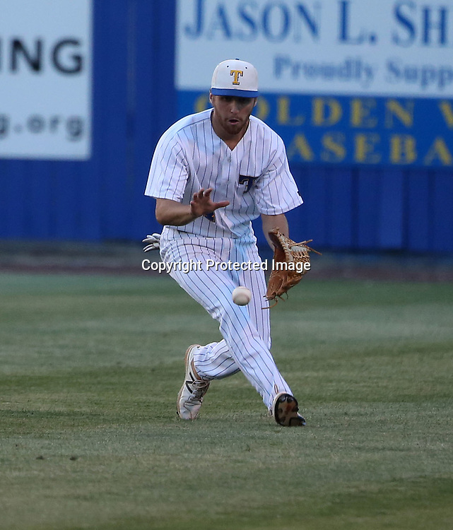 Tupelo's right fielder Tanner Jaggers keeps his eye on a ground ball looking to make a play against Hernando in the third inning.