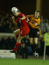 WOLVERHAMPTON, ENGLAND - Wednesday, January 21st, 2004: Liverpool's Sami Hyypia and Wolverhampton Wanderers' Kenny Miller during the Premiership match at Molineux. (Pic by David Rawcliffe/Propaganda)
