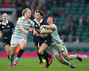 Twickenham, United Kingdom. Oxfords' Sophie TROTT, run is stopped by the clinging, CUWRC, Jessica CHARLTON during the  2016 Women's Varsity Rugby, [Oxford vs Cambridge], Twickenham. UK, at the RFU Stadium, Twickenham, England, <br /> <br /> Thursday  08/12/2016<br /> <br /> [Mandatory Credit; Peter Spurrier/Intersport-images]