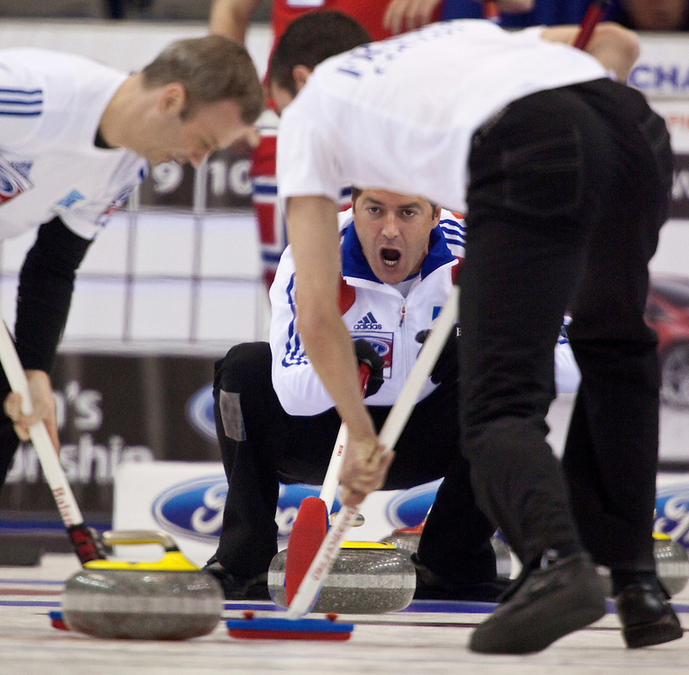 French skip Thomas Dufour, encourages his sweepers during France's tie breaker against Norway at the Ford World Men's Curling Championships in Regina, Saskatchewan, April 8, 2011.<br /> AFP PHOTO/Geoff Robins