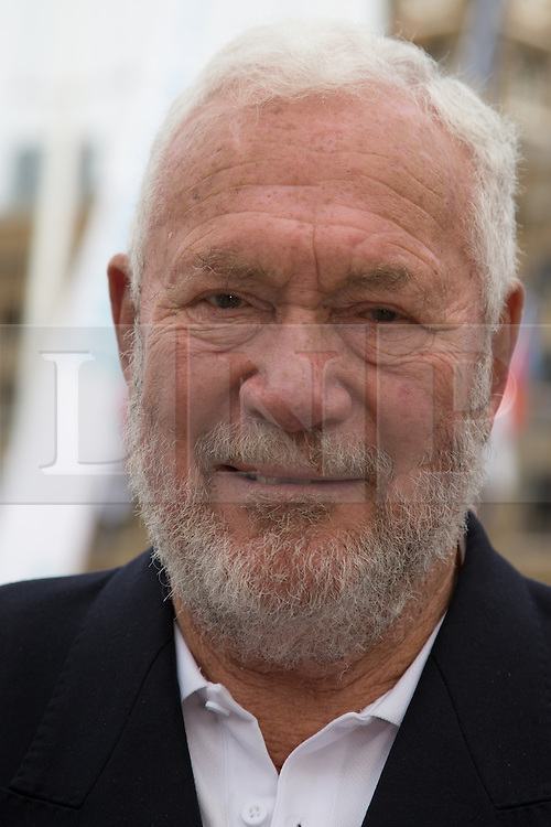 © Licensed to London News Pictures. 01/09/2013. London, UK. Sir Robin Knox-Johnston, the founder of the Clipper Round the World Race at St Katharine Docks ahead of the official start. The Clipper 2013-14 Round the World Yacht Race departs from St Katharine Docks on the River Thames.  Photo credit : Vickie Flores/LNP