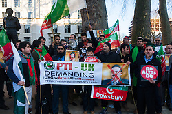 London February 15th 2015. British Pakistanis demonstrate outside Downing Street against Altaf Hussain a Pakistani politician living in exile as a naturalised citizen in the United Kingdom. The Muttahida Qaumi Movement (MQM) leader  is accused of masterminding dozens of politically motivated murders in Pakistan.    //Contact/payment details tel 07966016296 paul@pauldaveycreative.co.uk