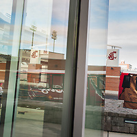 Washington State University has increased its branding along with a its new football stadium upgrades, adding bus wraps as its newest branding addition. (Rajah Bose for The New York Times)