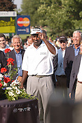 Jul 31, 2005; Grand Blanc, MI, USA; Tournament winner Vijay Singh tips his hat to the fans surrounding the eighteenth green at the 2005 Buick Open at the Warwick Hills Golf and Country Club.  Copright © 2005 Kevin Johnston