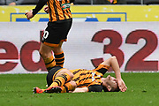 Hull City player Robbie McKenzie (27) is injured during the EFL Sky Bet Championship match between Hull City and Bristol City at the KCOM Stadium, Kingston upon Hull, England on 5 May 2019.