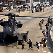 New Orleans residents are evacuated off I-10 freeway by helicopter where they have been staying since the aftermath of Hurricane Katrina in New Orleans, Louisiana .