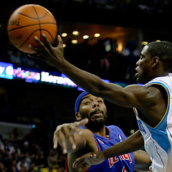 Dec 16, 2009; New Orleans, LA, USA;  New Orleans Hornets guard Darren Collison (2) passes the ball past Detroit Pistons center Ben Wallace (6) during the first half at the New Orleans Arena. Mandatory Credit: Derick E. Hingle-US PRESSWIRE