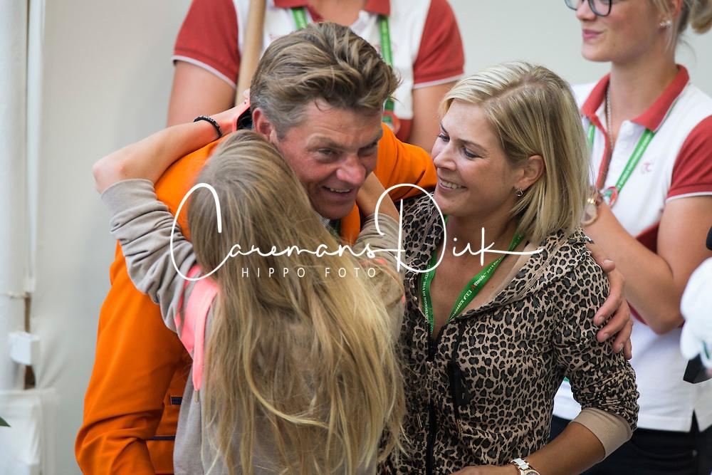 Jeroen Dubbeldam and his doughter Nina and girlfriend Annelies Vorsselmans - Jumping Final Four - Alltech FEI World Equestrian Games™ 2014 - Normandy, France.<br /> © Hippo Foto Team - Dirk Caremans<br /> 07/09/14