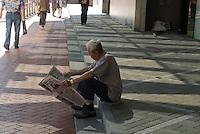 Man reading a newspaper, Pacific center, Admiralty, Hong Kong