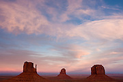 Monument Valley's most famous rock formations after a sunset in the desert.