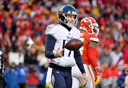 Jan 19, 2020; Kansas City, Missouri, USA; Tennessee Titans quarterback Ryan Tannehill (17) tosses the football after a turnover on downs during the AFC Championship Game against the Kansas City Chiefs at Arrowhead Stadium. Mandatory Credit: Denny Medley-USA TODAY Sports