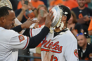 August 23, 2017 - Baltimore, MD, USA - The Baltimore Orioles' Manny Machado, right, gets pied in the face by teammate Jonathan Schoop after his 12th inning walk-off home run against the Oakland Athletics at Oriole Park at Camden Yards in Baltimore on Wednesday, Aug. 23, 2017. The Orioles won, 8-7, in 12 innings. (Credit Image: © Kenneth K. Lam/TNS via ZUMA Wire)