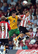 London - Tuesday, August 18th, 2009: Ryan Dickson of Brentford and Wes Hoolahan of Norwich City during the Coca Cola League One match at Griffin Park, London. (Pic by Chris Ratcliffe/Focus Images)