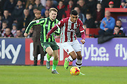 Jake Reeves of AFC Wimbledon chases down Jamie Reid of Exeter City during the Sky Bet League 2 match between Exeter City and AFC Wimbledon at St James' Park, Exeter, England on 28 December 2015. Photo by Stuart Butcher.