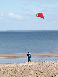 A man flies a kite on Portobello Beach in Edinburgh during a sunny first day of Autumn.<br /> <br /> Edinburgh Weather Pictures, Thursday 22nd September 2016<br /> <br /> (c) Alex Todd | Edinburgh Elite media
