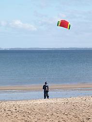 A man flies a kite on Portobello Beach in Edinburgh during a sunny first day of Autumn.<br /> <br /> Edinburgh Weather Pictures, Thursday 22nd September 2016<br /> <br /> (c) Alex Todd | Edinburgh Elite media