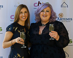Pictured: Michelle McManus and Claire McNab-Wilson (whose daughter Emmie died last year while being supported by CHAS)<br /> Michelle McManus entertained the women who attended todays' annual Children's Hospice Across Scotland (CHAS)  fundraising lunch at Prestonfield House Edinburgh. <br /> <br /> CHAS have been offering full family support for babies and young people with life shortening conditions for the last 20 years.<br /> <br /> Ger Harley | EEm 2 November 2018