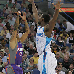 03 December 2008:  Phoenix Suns forward Matt Barnes (22) shoots over New Orleans Hornets center Hilton Armstrong (12) during a 104-91 victory by the New Orleans Hornets over the Phoenix Suns at the New Orleans Arena in New Orleans, LA..