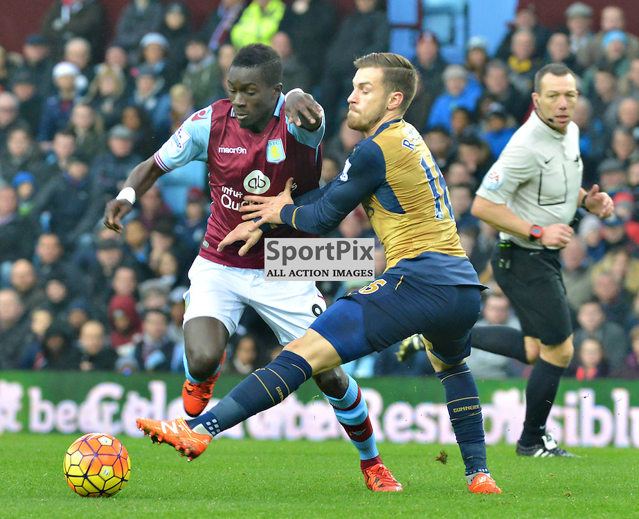 Idrissa Gana of Villa holds off Aaron Ramsey of Arsenal......(c) BILLY WHITE | SportPix.org.uk