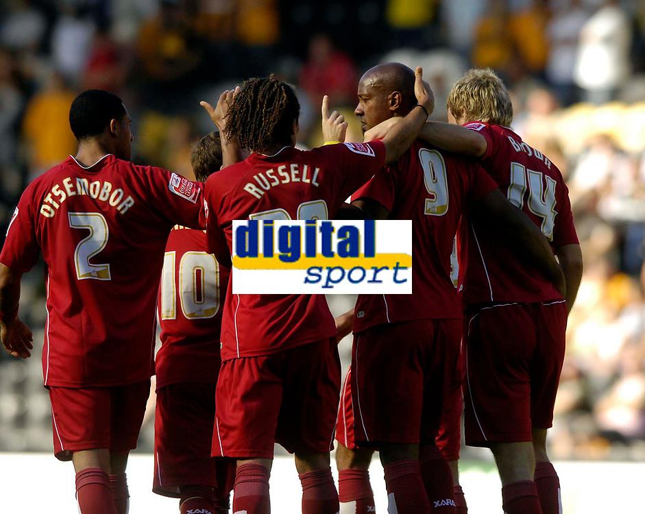 Photo: Jed Wee/Sportsbeat Images.<br /> Hull City v Norwich City. Coca Cola Championship. 25/08/2007.<br /> <br /> Norwich congratulate goalscorer Dion Dublin (9).